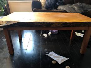 Side view of a Mahogany and Spalted Wormy Maple coffee table